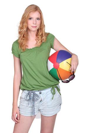 beach ball girl: Young woman holding a beach ball Stock Photo