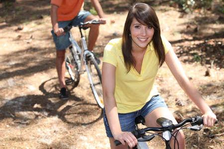 Couple on bicycle photo