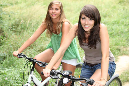 Two girls on a bicycle photo