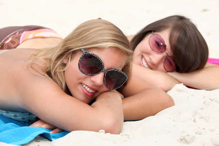 Two teenage girls sunbathing photo