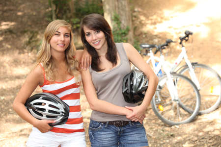 mountainbiking: Girls mountain-biking Stock Photo