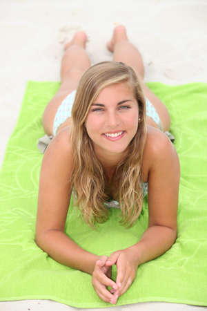 dirty blond: Young woman sunbathing at the beach