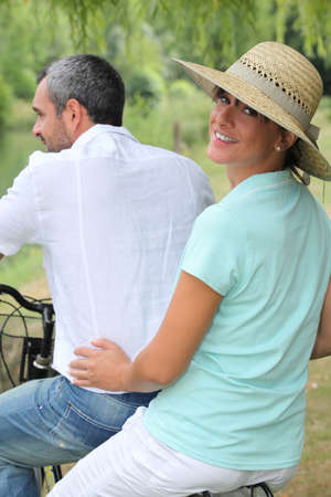 tandem bicycle: Couple riding on a bike together