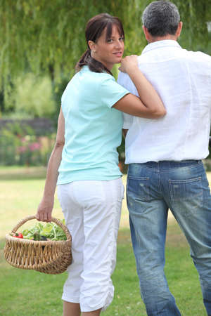 Man and woman with a basket of fruit Stock Photo - 13885083