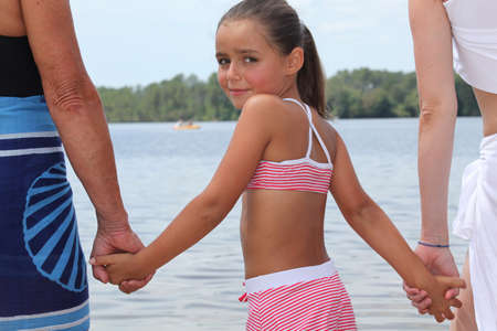 Young girl afraid of the water Stock Photo - 13884448