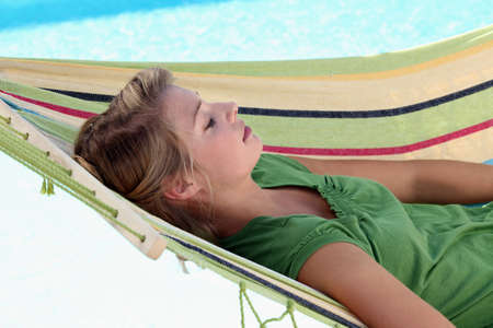 Young woman resting on a hammock photo
