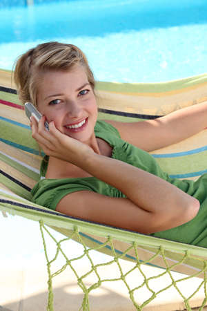 fringes: Teen in a hammock with cellphone