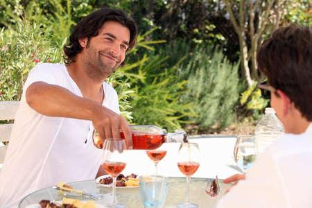 alfresco: Friends drinking wine outdoors