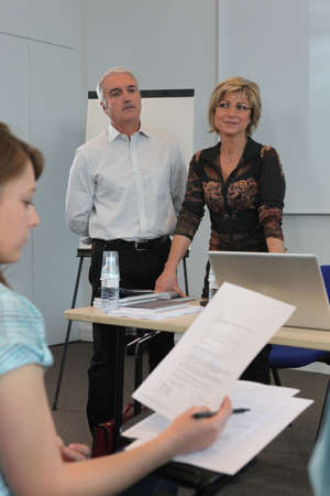 Teachers supervising an exam photo