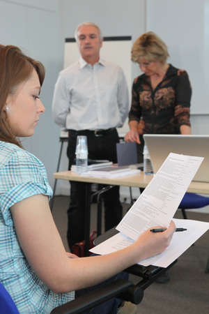 memorise: young woman in examination