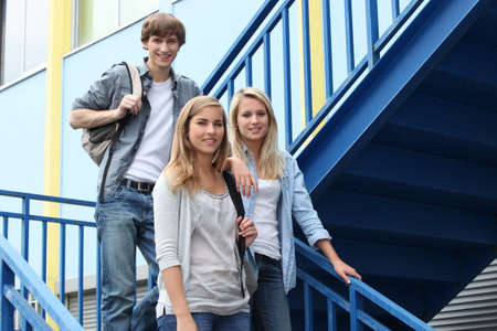 high school girl: portrait of students in stairs