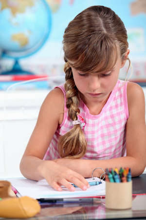 little girl drawing at school Stock Photo