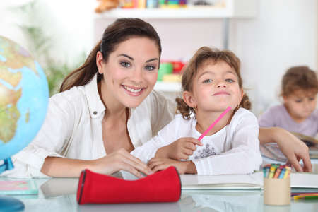 infant school: Teacher with a little girl Stock Photo
