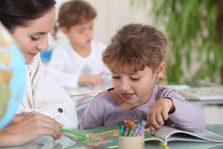 kindred: Teacher with a little girl Stock Photo