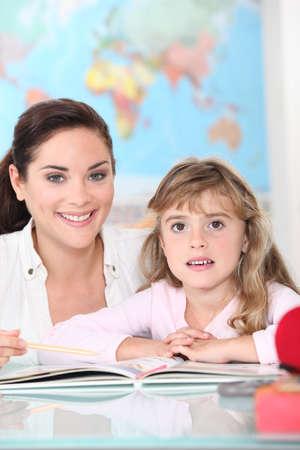 waxes: Teacher and girl in school