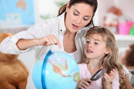 little girl learning geography with mom photo