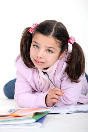 Little girl doing schoolwork Reklamní fotografie