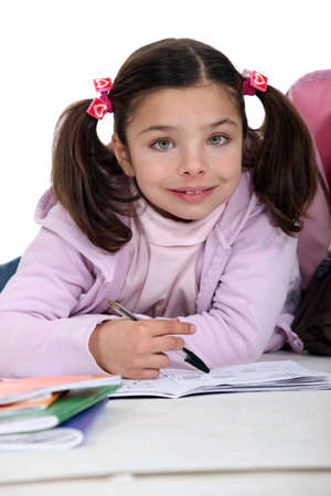 pigtails: Young girl doing her homework