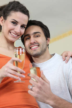 Couple drinking a celebratory drink Stock Photo - 13914313