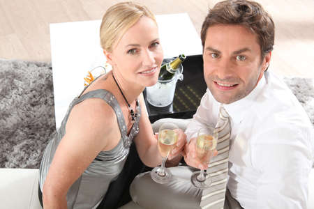 Couple drinking champagne photo