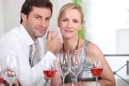 Couple sat at table enjoying intimate meal photo