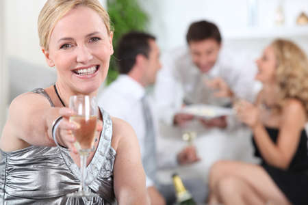 Woman holding champagne Stock Photo - 13906429