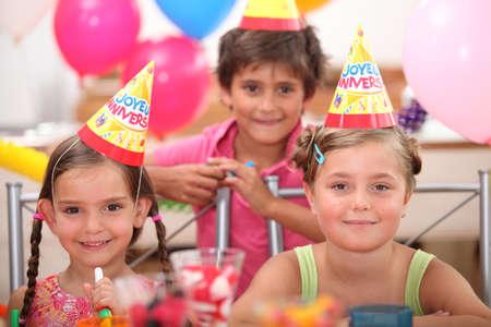 birthday party kids: portrait of children at birthday party