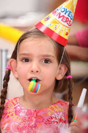 childs birthday party: Young girl at a childs birthday party