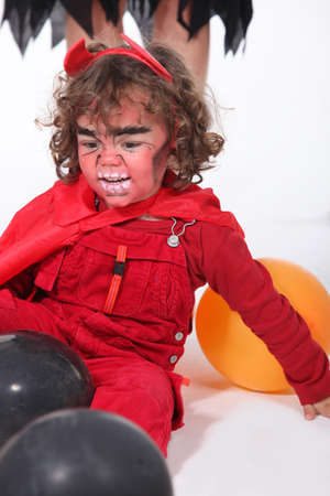 Little boy dressed as devil photo