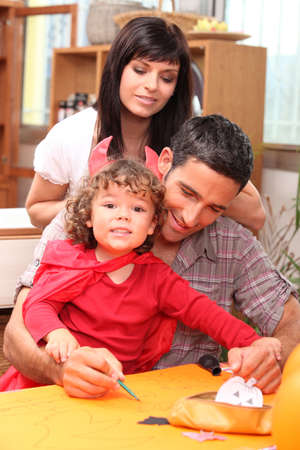 single parents: Parents and child preparing for Halloween Stock Photo
