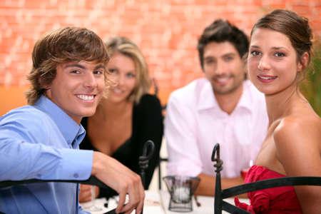 Family sat in restaurant photo
