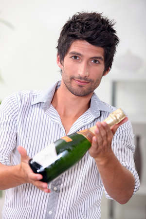 verve: Man with bottle of champagne