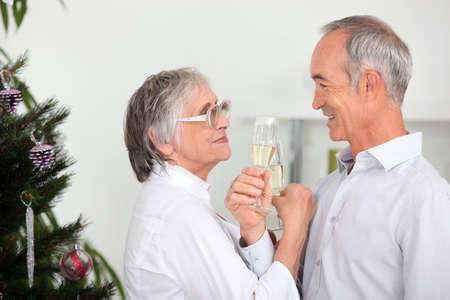 Old couple celebrating Christmas photo
