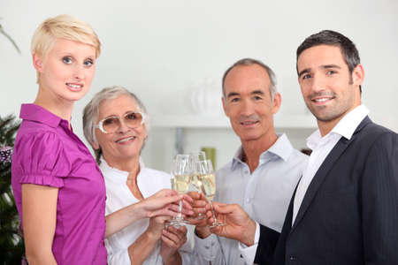 Two couples toasting with champagne photo