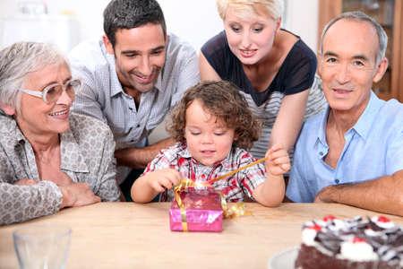 Family celebrating a birthday together photo