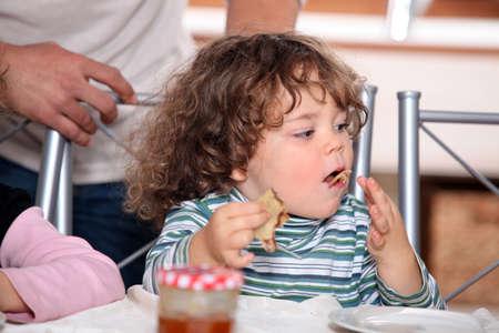 Little boy eating pancakes Stock Photo - 13914037