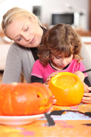 Woman and girl with pumpkins photo