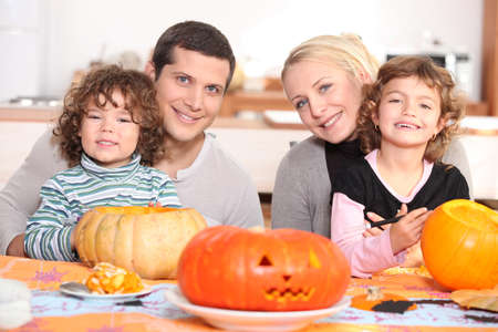 Young family carving pumpkins photo