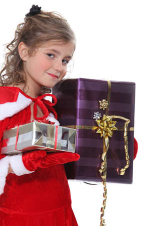 velvet dress: Girl dressed as Santa Claus with gifts
