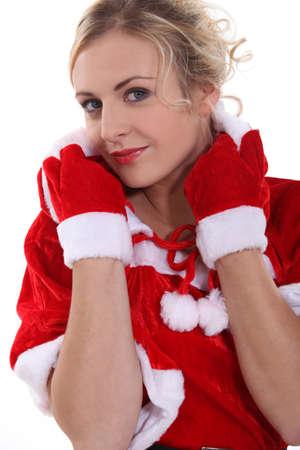 hesitations: Blond woman wearing seductive Santa costume Stock Photo