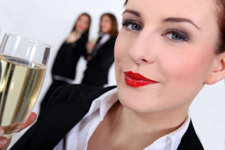 successful businesswoman drinking champagne Stock Photo - 13906009