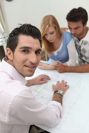 purchasers: Couple looking at property plans Stock Photo