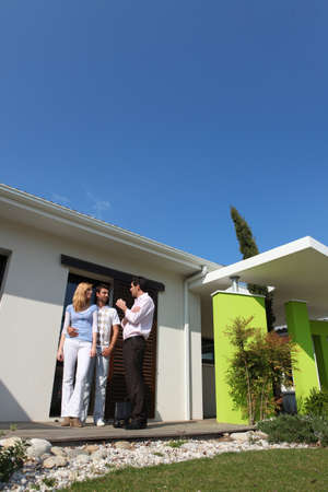 accommodation broker: Young couple viewing potential house purchase