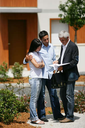 real estate agent: Real estate agent with clients