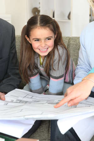 eight years old: Parents and daughter having meeting with architect Stock Photo