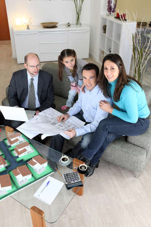 signing papers: Family buying new house Stock Photo