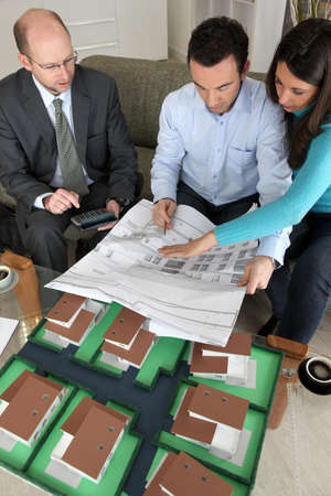 Young couple looking over new house plans photo