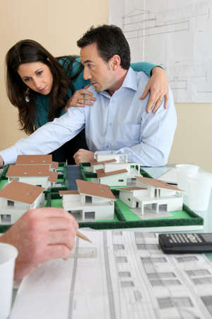real-estate promoter and couple photo