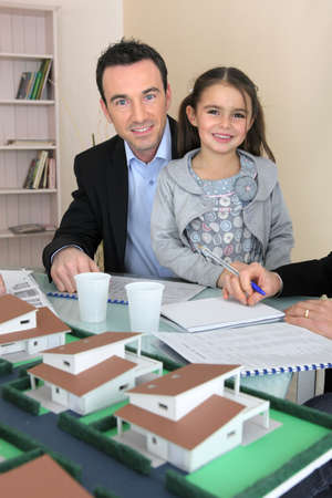Father and daughter in architect firm photo