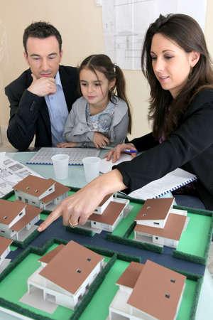 regiments: Parents showing daughter new house plans Stock Photo
